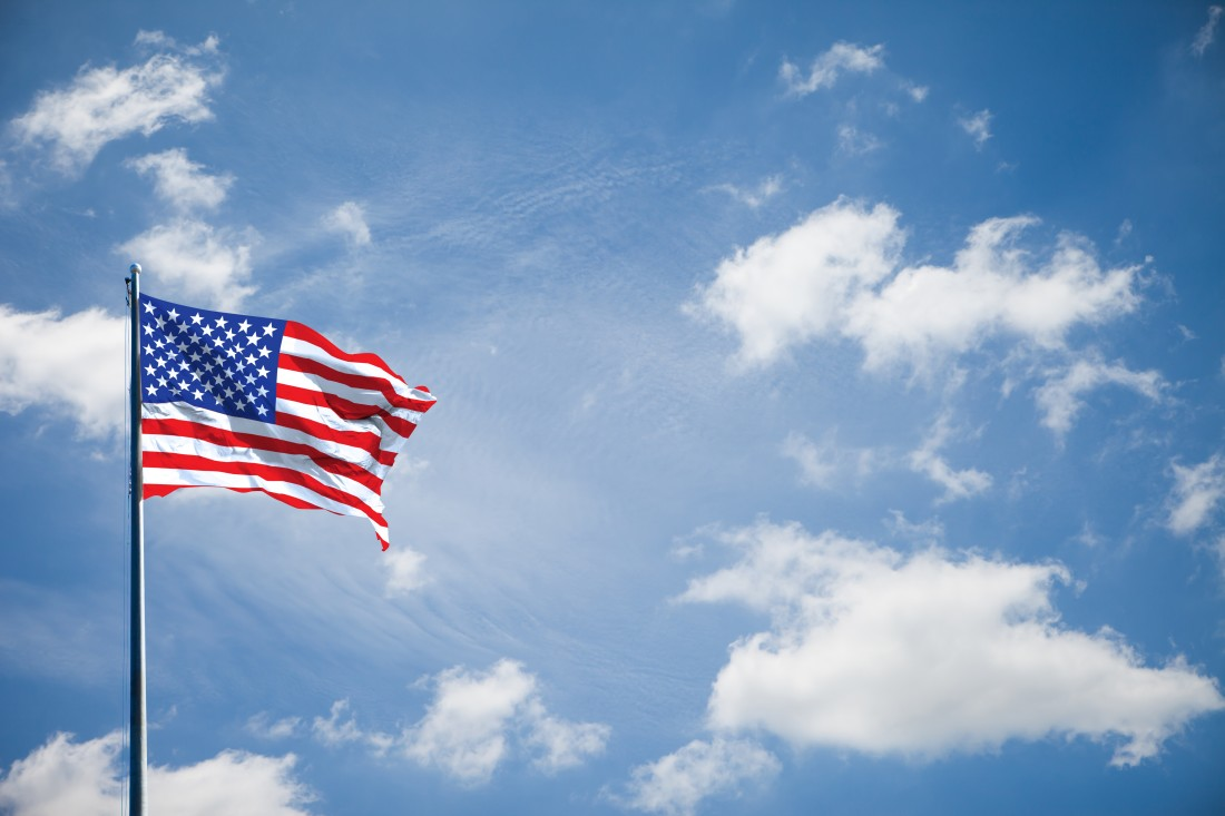 Photograph of American Flag on blue sky