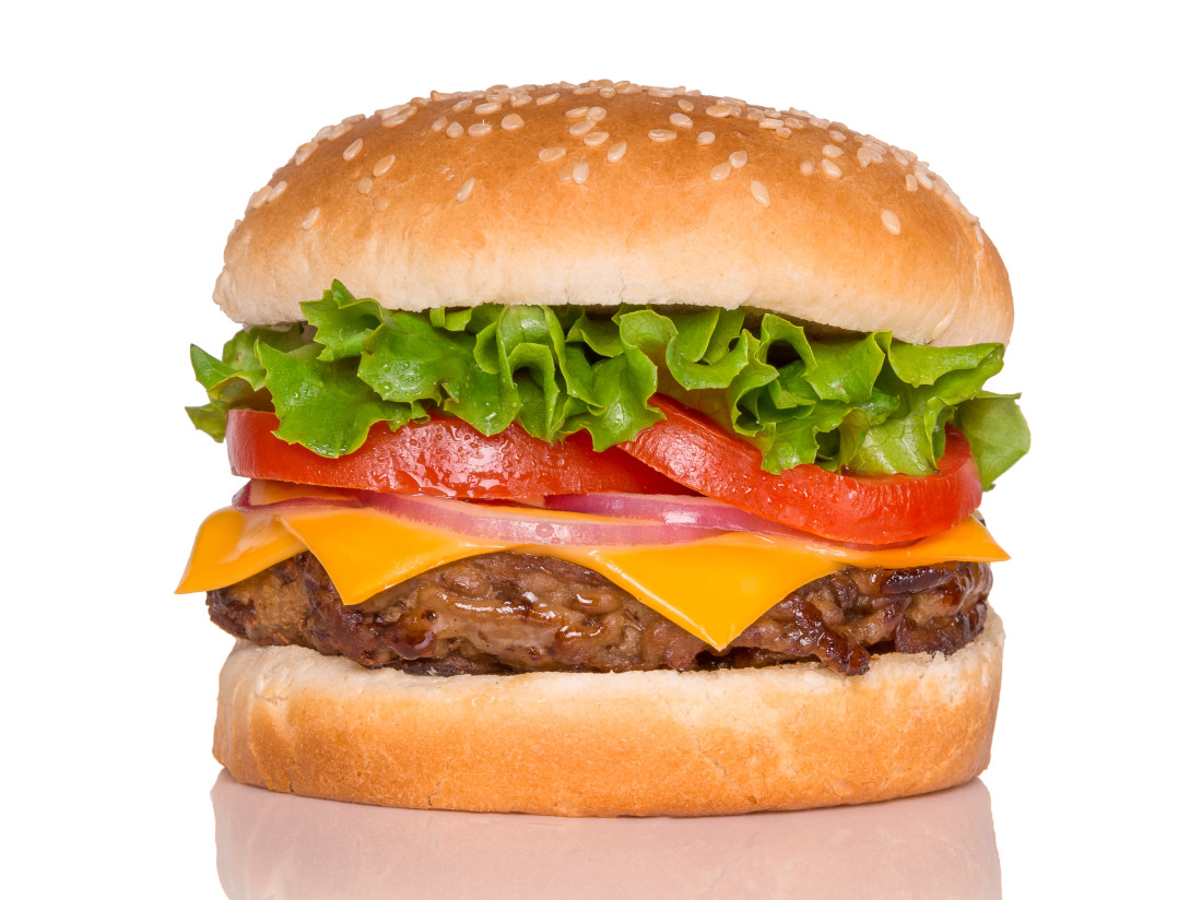 (Bottom to top) Bun, burger patty, cheese, onion rings, tomato slices, lettuce, sesame seed bun