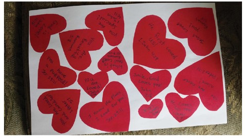 Court exhibit of various sizes of red heart-shaped cards displaying messages