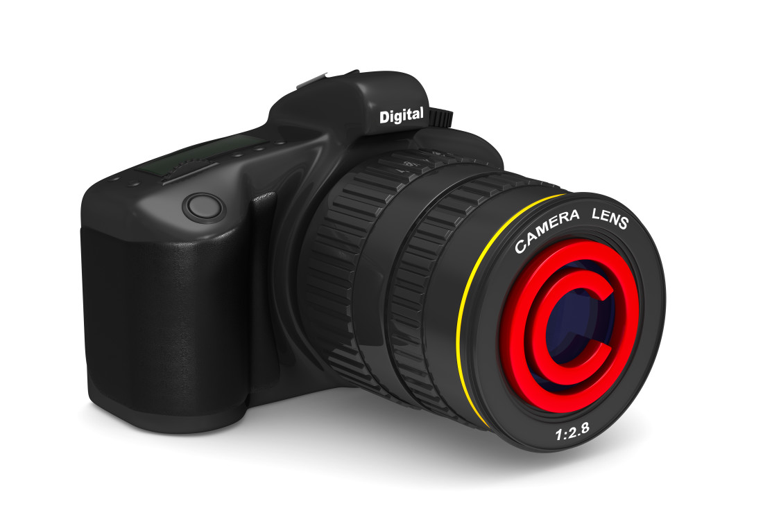 "Digital Camera with a Circled ""C"" on the lens"