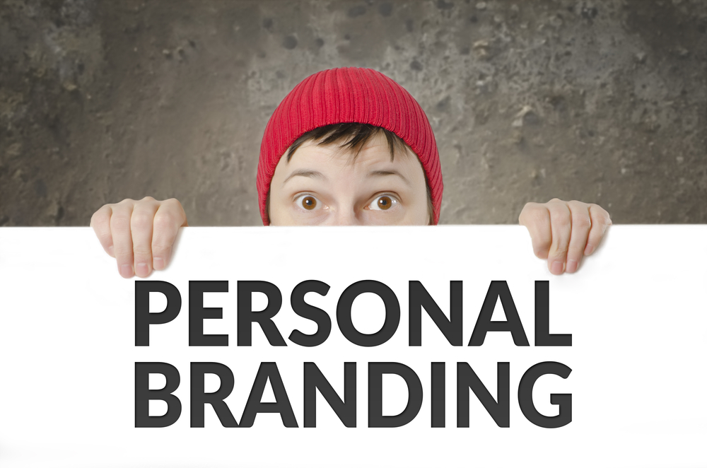 "Person holding sign that says ""Personal Branding"""