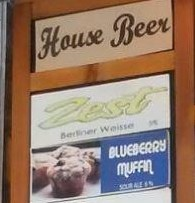 "Specimen sign with a ""House Beer"" heading and a BLUEBERRY MUFFIN listing below"