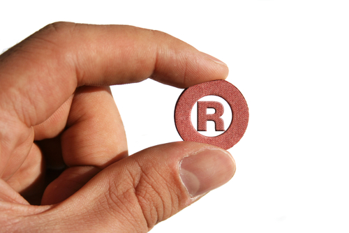 Trademark R Symbol in Hand