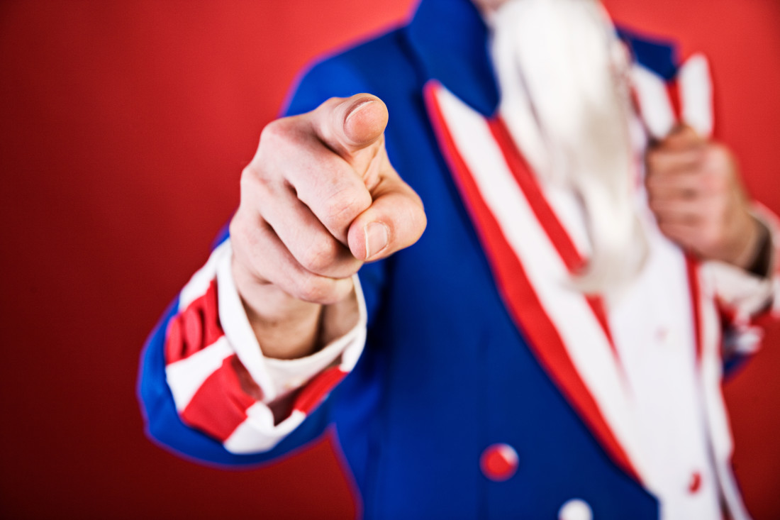 Photo of figure in suit resembling the American Flag