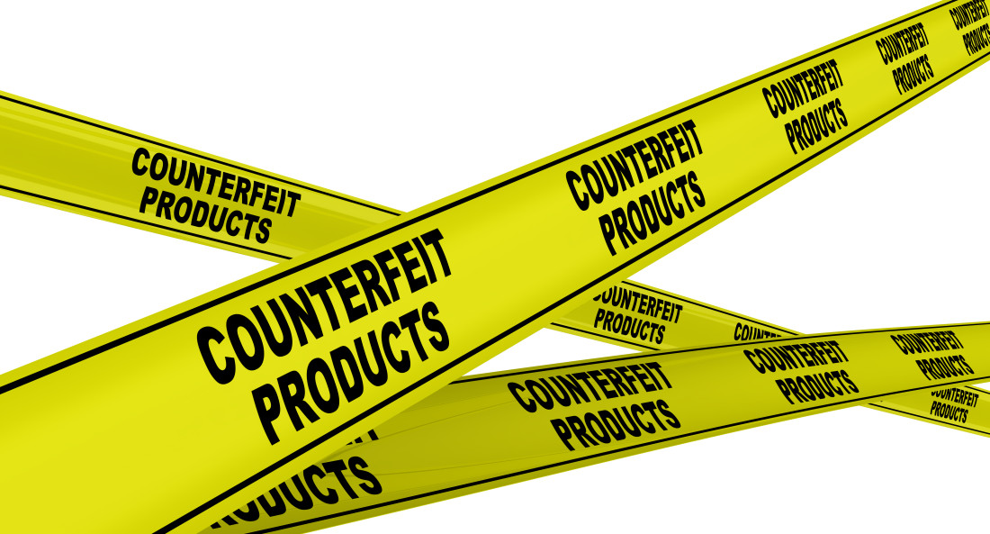 Yellow warning tapes with repeating black text COUNTERFEIT PRODUCTS