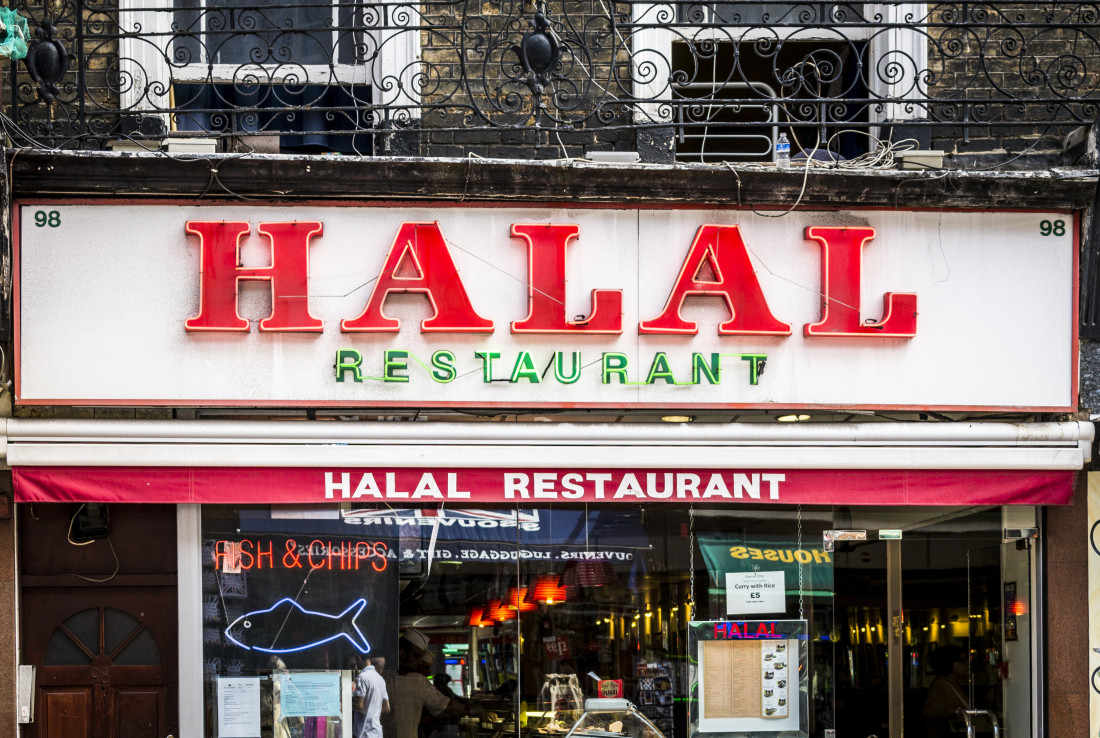 Restaurant sign awning both displaying HALAL RESTAURANT